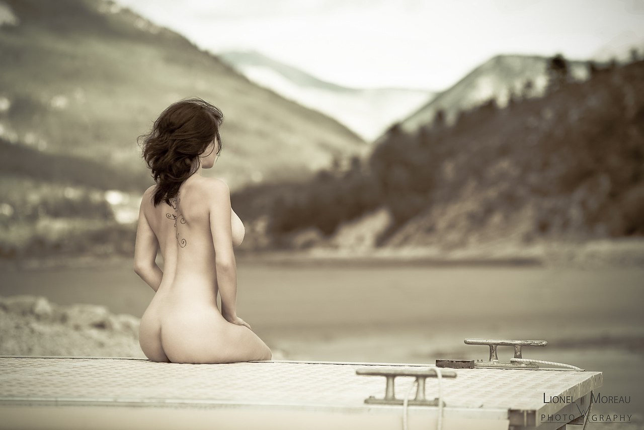 Young Nude Woman On Sandy Beach
